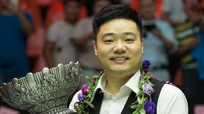 Ding Earns Sport at Champion of Champions